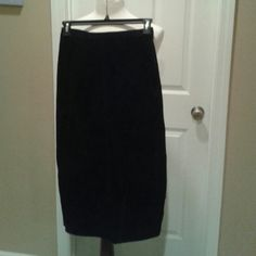 Genuine Suede Black Skirt Genuine Suede black fully lined with split into the back.  The skirt has a back zipper with metal snap closure. The skirt has detailed seams. Excellent condition only worn twice no stains just had the garment professionally cleaned to sell. Skirts A-Line or Full