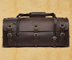 What makes a duffel bag a beast? Bigness. Ruggedness. Resilience. What makes a duffel bag The Beast? According to Saddleback Leather, all of the above, plus a 100-year warranty (yes, that's one hundred), a mere 3 seams binding 4 slabs of full-grai Leather Suitcase, Leather Luggage, Leather Purses, Leather Bags, Saddle Leather, Saddleback Leather, Leather Company, Duffel Bag, Leather Working
