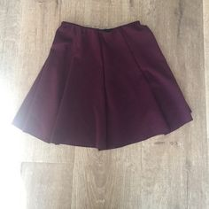Brandy Melville Burgundy Skater Skirt Very cute skater skirt. Size small, unlike other Brandy Melville items which are O/S. (But would fit an x-small) Brandy Melville Skirts Circle & Skater