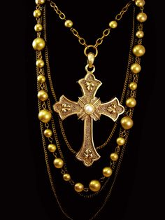 """Huge Medieval Cross necklace layers of brass and chains. Swags of chains and vintage brass beads hold this massive gothic cross with faux pearl center. The necklace can be worn and more than one length ( up to 25"""") and it has a bib length of 7"""" in the front. Very medieval in style and heavy and well made. The brass has aged nicely so it really sets off the cross. Ask about our ten percent off special before you buy, it could save you a lot of money. VintageSparkles offers Layaway on all our ..."""