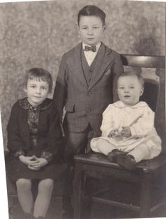 The baby's future husband seated ~ 1929
