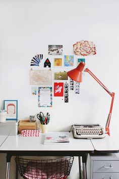 Design Sponge/  My workspace with desk, lamp and vintage typewriter. The Diamond chair is by Harry Bertoia. The illustration in the blue fra...