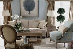 Beautiful, calming colors; great furniture and art. Love! Love the beachy colors in this room. The Versailles chair is beautiful in pale blue and cream and looks great with the gray-brown finish of the wood.