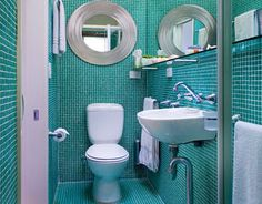 I love these turquoise tiles, but I think tiling every surface would get a little claustrophobic.