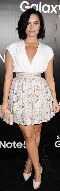 Who made  Demi Lovato's nude bow clutch handbag, white top, and platform pumps?