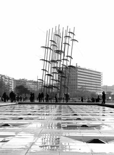 """Sunday morning scene in the waterfront of Thessaloniki near the famous installation of """"Umbrellas"""" by the sculptor Giorgos Zogolopoulos in black and white."""
