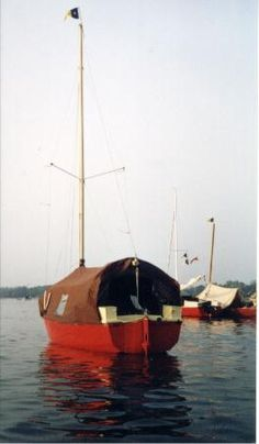 A roomy canvas tent on a Roamer - a 14' self-righting boat designed by the UK's Dinghy Cruising Association for the home builder.