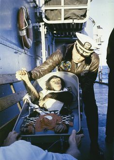 The famous hand shake welcome. After his flight on the Mercury Redstone rocket, chimpanzee Ham is greeted by the commander of the recovery ship, USS Donner (LSD-20).