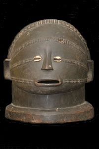 """Tabwa Helmet Mask1 of 3 « Inquire About This Item » """"Shows the elaborate and attractive patterns and designs worked into the skin according to the Tabwa concept of kulemba that reflect aesthetics, social membership, and the abstract idea of order upon the chaos of nature. The mask illustrates the scars necessary for a person to be viewed as a complete adult. $1200"""""""