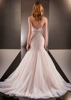 Zaffiro is a stunning tulle fishtail gown, which has a sweetheart neckline, beaded Lace appliques on the bodice, and an elegant chapel train. The stunning beaded belt perfectly accentuates the waist of this wedding gown. #MartinaLiana #Eleganza #EleganzaSposa #Bridal #WeddingDress #Romantica #BridalBoutique #Glasgow #Scotland