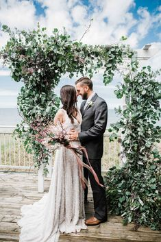 Beach wedding ceremony backdrop/arch - Love by the Shore: A Michigan-Inspired Style Shoot | WeddingDay Magazine