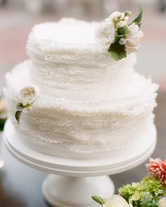 At Lauren and Christopher's D.C. wedding, Maggie Austin, collaborating with the couple's florist, whipped up this angelic dessert featuring white-velvet cake with raspberry and vanilla-lime buttercream and double chocolate cake with hazelnut and Frangelico buttercream.