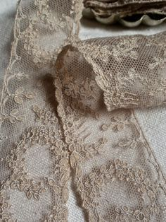 Antique embroidered net lace. Dusty old pink/purple ish colour. Details. Trimmings, embellishments.
