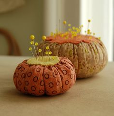I think these look like pumpkins, So why not theme your sewing accessories...A pin cushion for every season.