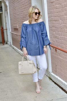 Spring and Summer Trends: Off the Shoulder Chambray Top, White Jeans, Beige Satchel and Beige Sandals for a Cute Casual Outfit.