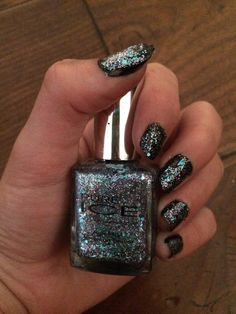 This is a design I did my self with black Nail polish as the base and sparkle Nail polish as the top.