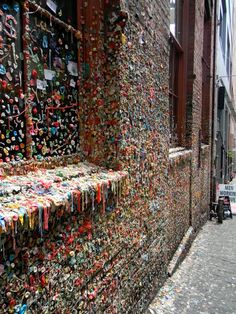 Gum Wall- Tourist attraction.. Seattle Washington..Located in Post Alley, under Park Place Market,  beginning in the early 1990s, when people, irritated that they had to wait in line to get tickets to the theater, stuck chewing gum on the wall