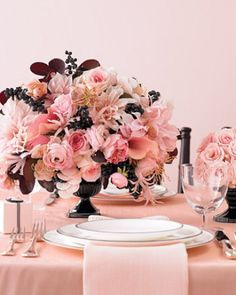 Martha Stewart I This bold ranunculus and garden rose arrangement is accented with peach calla lilies, bottlebrush, grevillea, dahlias, spider lilies, and vintage velvet, while European privet berries and smoke-bush leaves are scattered throughout.