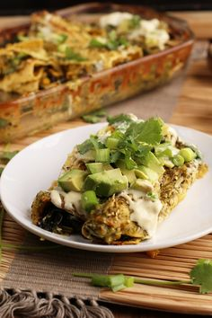 These Vegan Enchiladas Verde are made with roasted zucchini and corn and topped with homemade salsa verde for a healthy and delicious plant-based dinner
