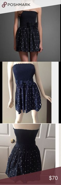 A&F Strapless Navy Blue&White Polk Dot Dress Sz XS A&F Strapless Navy Blue & White Polk Dot Dress Sz XS. Elastic navy blue bodice with navy skater skirt with white polka dots. Fully lined. Bow belt detail. Measurements: Chest Circumference: 20 inches/ Waist Circumference: 20 inches/ Hip Circumference: 31 inches/ Length: 22 inches. Materials: 100% cotton. Abercrombie & Fitch Dresses