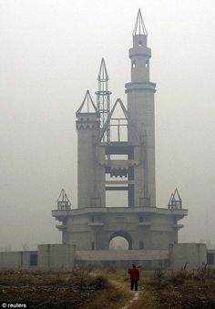 A half-finished medieval-style tower sits abandoned on the Wonderland site near Beijing