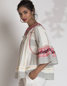 Handloom Cotton Blouse in dobby pattern with temple border in Zari. Intricately embroidered signature florals with hand tucked french knots adds to the luxury. Western Tops, Western Wear, Ladies Suits, Suits For Women, Cotton Blouses, Cotton Dresses, Short Kurtis, The Office Shirts, Designer Party Wear Dresses