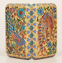 A Russian silver gilt and plique-a-jour enamel cigarette case, apparently unmarked, Moscow, circa 1900. Of rectangular form with rounded corners, both sides of the case decorated in pierced translucent plique-a-jour enamel featuring mythical bird motifs with scrolling foliate and floral designs within a geometric cloisonné enamel border.