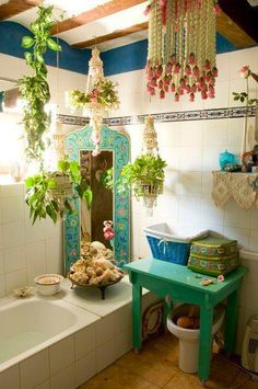 Bohemian bathroom... mirror tub plants turquoise