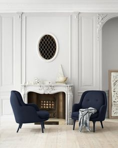 French apartment with ornate fireplace mantel and arm chairs