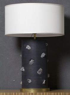 Limited edition of brut steel lamp with clear quartz, natural brass base, white silk shantung lampshade (diameter cm.50 x height 24).