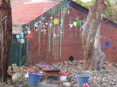 Another interesting view. Children are very present in this space with their supplies and artwork. I really love all the rocks. I personally love the background of a built structure, especially since it is worn and has characters. Jells Park Preschool in Monash city