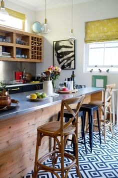 The slim proportions of this island nonetheless allow it to seat at least four diners, with room left over for a stove, utensils, and essential ingredients.  Kitchen Island Breakfast Bar Ideas & Inspi (Ingredients Design Apartment Therapy)
