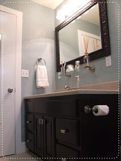 Perfect Blue Bathroom -- just what I'm looking for! light blue walls, dark cabinet...