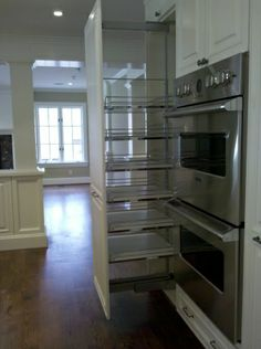 No more dark isolated kitchen, Brighten an existing kitchen and open it up to the flanking unused living space., After: pull out pantry unit...
