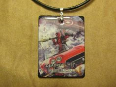 "Deadpool Vs Shield Lola Necklace with 2.5"" by 2"" pendant with Custom Length Leather Necklace One of a Kind from actual pages of a comic Agent Coulsons car"