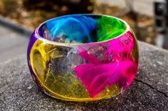 Parrot like feathers in colored transparent resin от PAGANEuniques