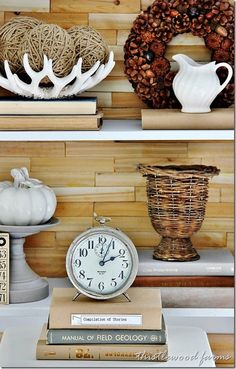 Want to know how to decorate a bookcase? Here's 5 easy tips to decorate a bookcase. 5 simple things that every bookcase needs when you are decorating.