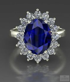 Oval cut AAAA blue tanzanite surrounded by white diamonds- A regal jewel from Luxedogems.com