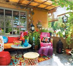 Bohemian patio- this is the color palette I want in my dining room!