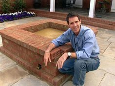 DIY brick fire pit. Love how raised this one is....who wants to look down all the time??? LOVE that it's square....circles are kind of boring.