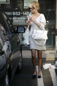 Nicole Richie. I love this casual sweater dress and her layered hair falling out of a low bun