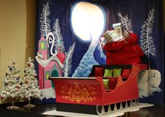 """Whoville"" 2012 Christmas set. Massive hand painted mural and custom hand built and painted sleigh. Families could go in the sleigh and have their holiday pictures taken."