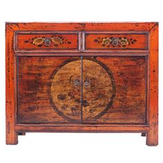 Shabby chic oriental sideboard. This little sideboard is finished in a distressed, orange lacquer and decorated on the two drawers and doors with paintings of flowers - typical designs seen on furniture from China's western provinces. #ShabbyChicSideboard #OrientalSideboard