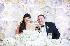 lisa stoner events- bride and groom- white paper flower wall- orlando luxury weddings- bride and groom. Wedding Reception Flowers, Wedding Bride, Wedding Events, Lace Wedding, Weddings, Reception Table Decorations, Wedding Ceremony Decorations, Flower Centerpieces, Wedding Centerpieces