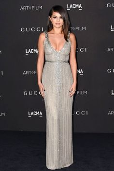 Selena Gomez in a fitted silver beaded Gucci gown