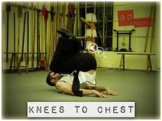 Bring the knees (bent) to chest, contract the abs and hold before releasing the feet back down, without touching the ground.