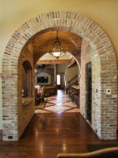 Between the arches: a bar on one side, wine cellar on the other - above: stunning brick groin vault. Wow.