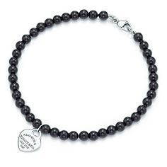 Tiffany & Co. | Item | Return to Tiffany™ mini heart tag in silver on a black onyx bead bracelet. | United States