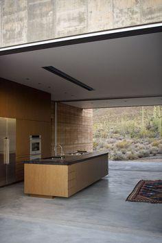 Concrete floors + sliding glass walls on both sides