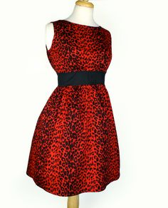 Rockabilly Pinup Classic Red  Pinup Leopard Print Dress / Pin Up Rockabilly Dress. $49.00, via Etsy.